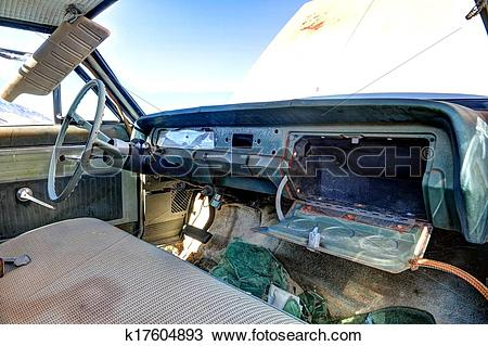 Stock Photo of Old abandoned car interior with open glove box.