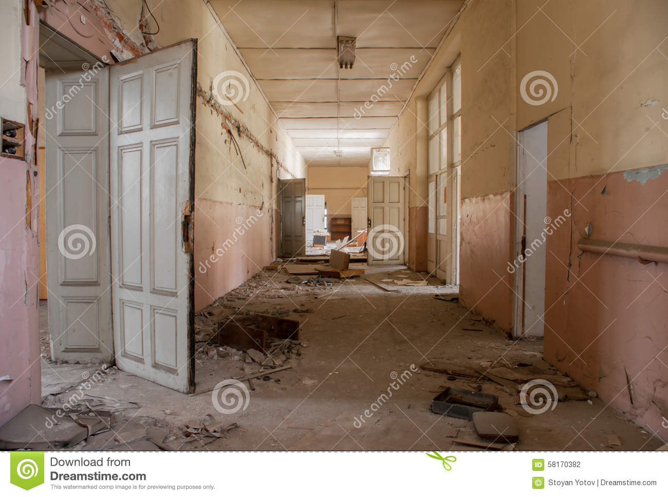 Dirty Empty Corridor At Abandoned School Building Stock Photo.