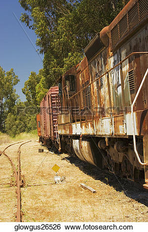 Stock Images of Abandoned freight train on railroad track.