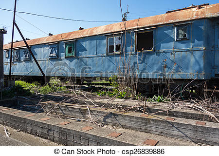 Pictures of Old abandoned trains in sunny day.