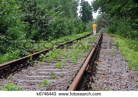 Stock Photo of Walking Away Down Abandoned Railroad Track k6746443.