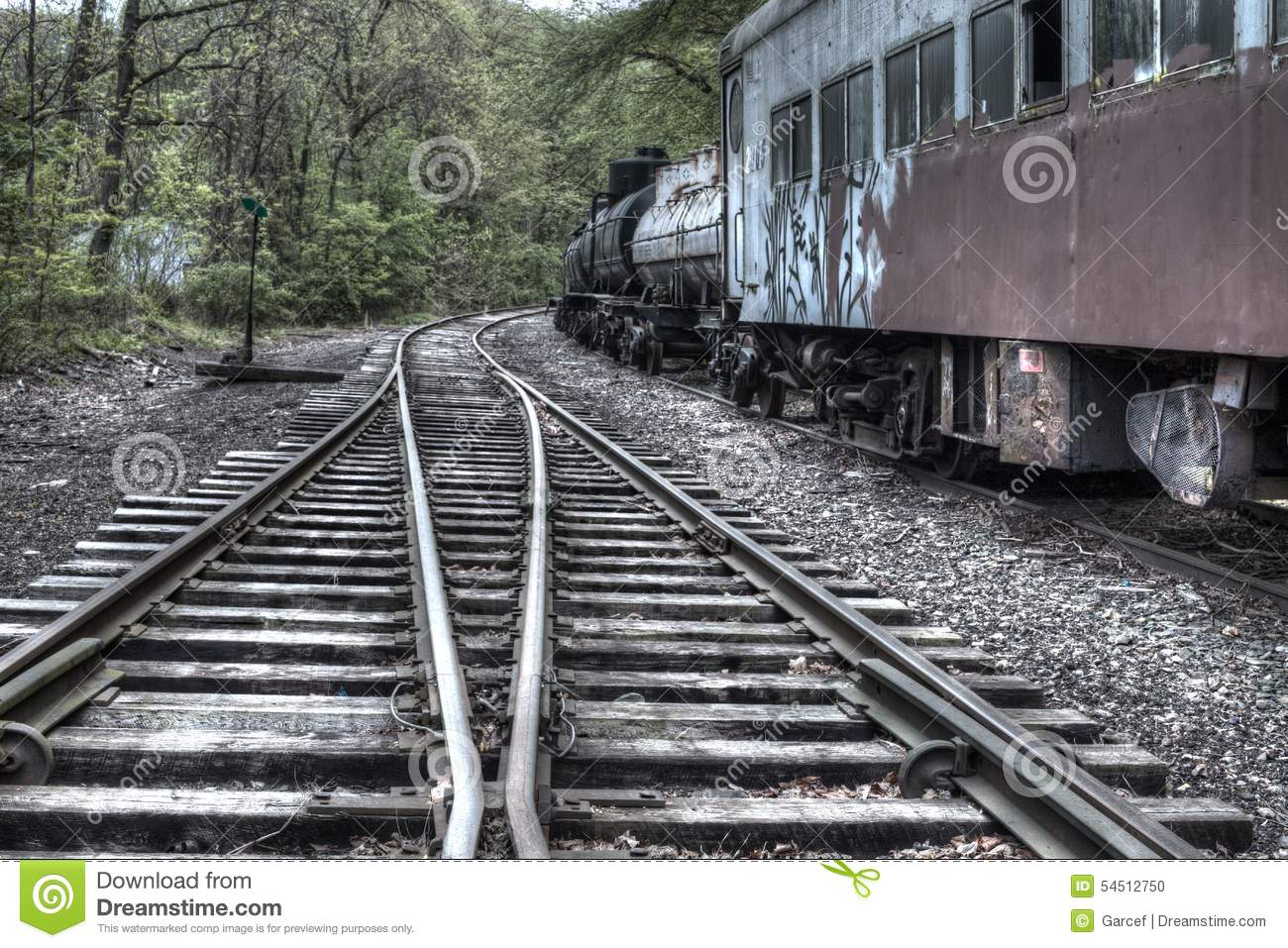 Train Tracks And Abandoned Train Car Editorial Image.