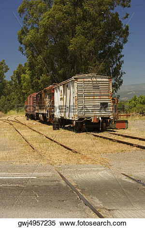 Stock Image of Abandoned freight train on railroad track.
