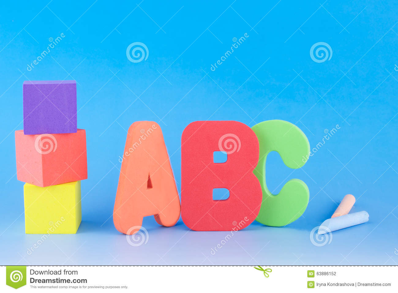 ABC Letters, Foam Cubes And Chalks Stock Photo.