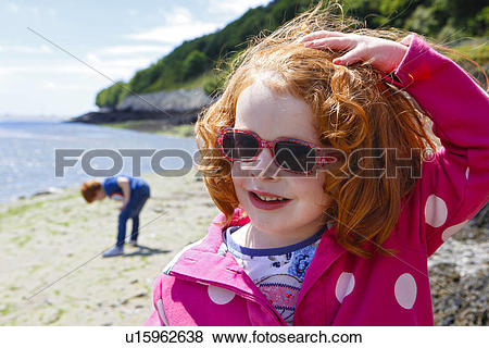 Pictures of Wales, Gwynedd, Aberdovey. Young red haired girl.