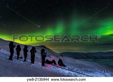 Stock Photo of People enjoying and photographing the Aurora.