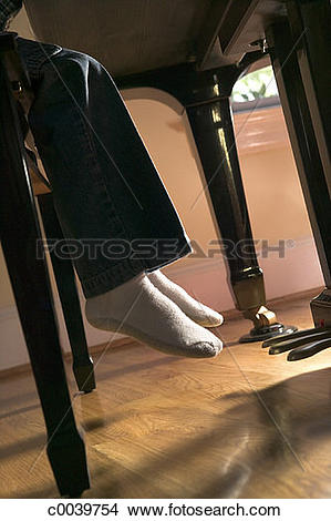 Stock Photo of Child's Feet Don't Reach Piano Pedals c0039754.