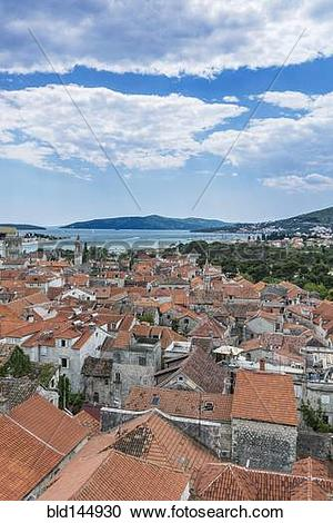 Stock Photography of Aerial view of coastal city rooftops under.