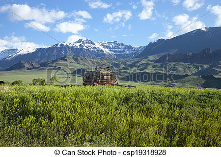 Stock Photo of Old covered wagon in the Absaroka Mountains of.