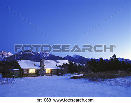 Pictures of Ranch cabin in winter twilight, Absaroka Mountains in.