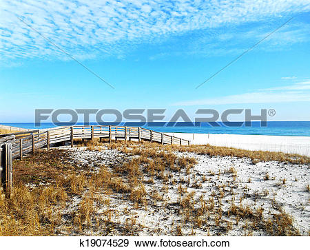Stock Photograph of Pedestrian bridge across the dunes for easy.
