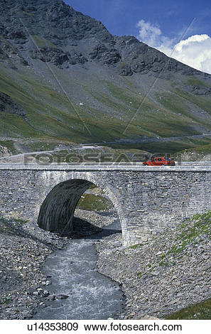 Stock Photograph of Alps, Bridge, France, Europe, Red car driving.