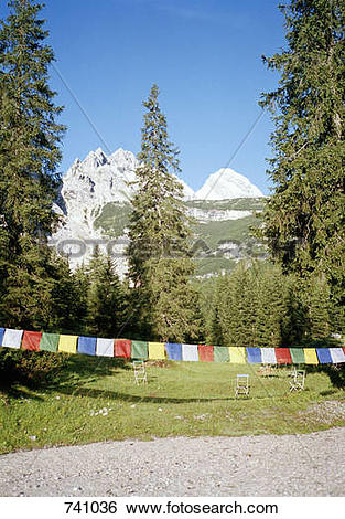 Stock Images of Multicolored bunting across a garden in the.