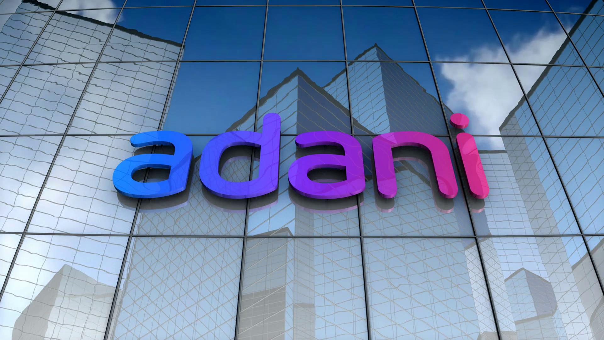 Editorial, Adani Group logo on glass building..