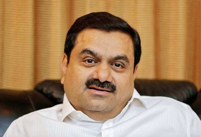 Adani, Total join hands to set up retail network, LNG terminal.