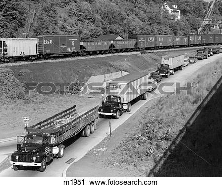 Stock Photography of 1950S Line Of Traffic With Many Trucks & Cars.