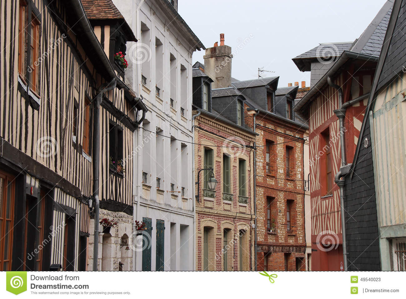 Adjoining Buildings Were Built In Different Styles In Honfleur.