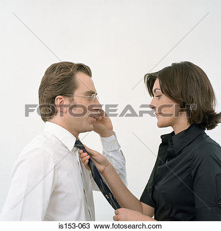 Stock Photo of Woman adjusts tie on man is153.
