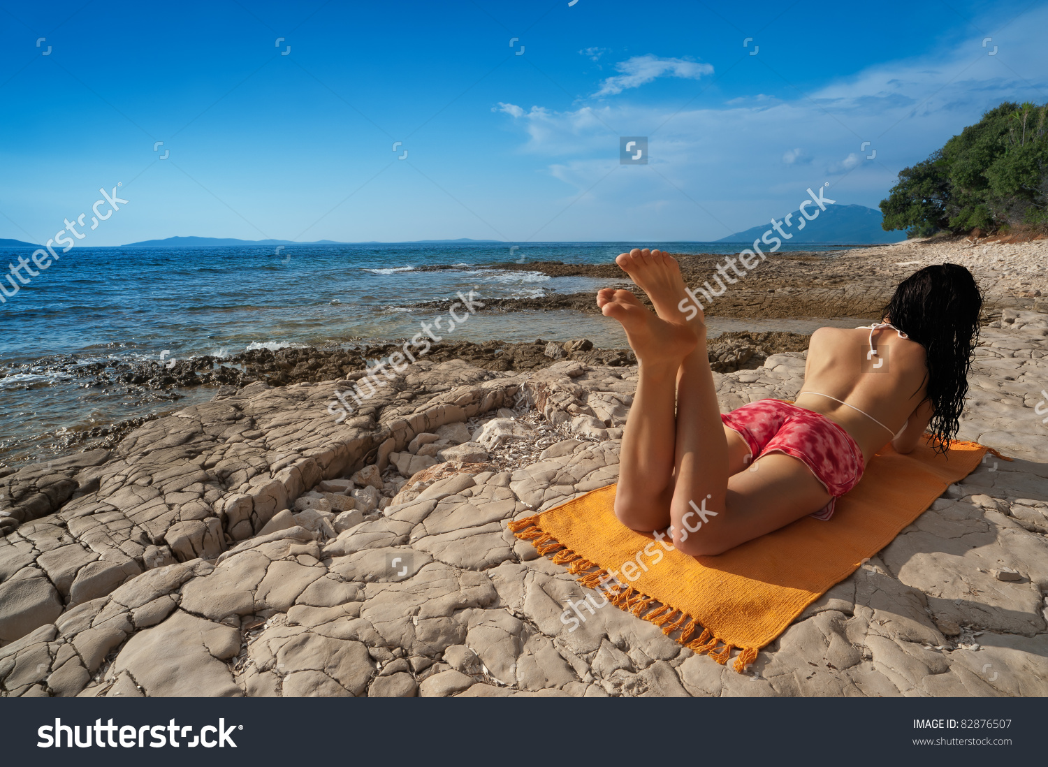 Young Woman On Wild Island Beach Stock Photo 82876507.