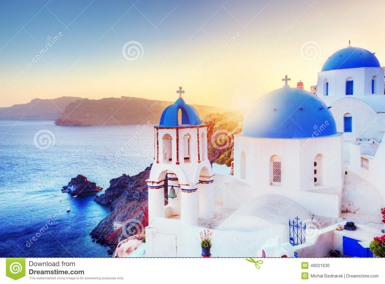 Oia Town On Santorini Greece At Sunset. Aegean Sea Stock Photo.