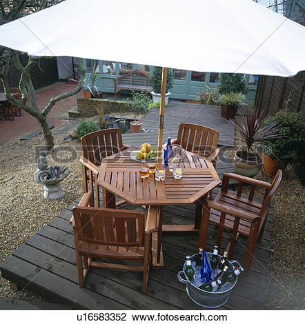 Stock Photo of Aerial view of white parasol above wooden table and.