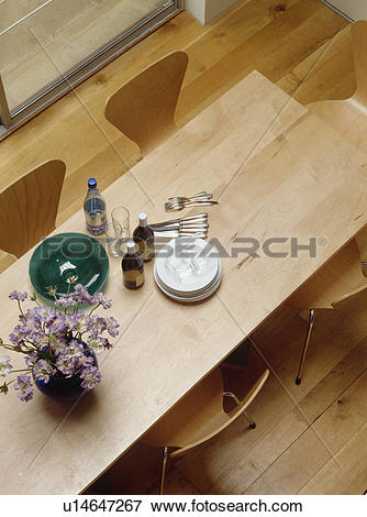 Picture of Aerial view of plates and cutlery on modern wooden.