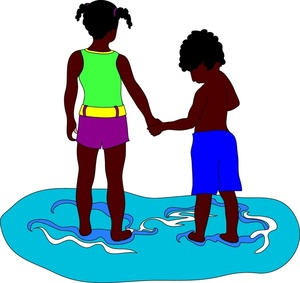 African American kids, brother and sister, holding hands at.