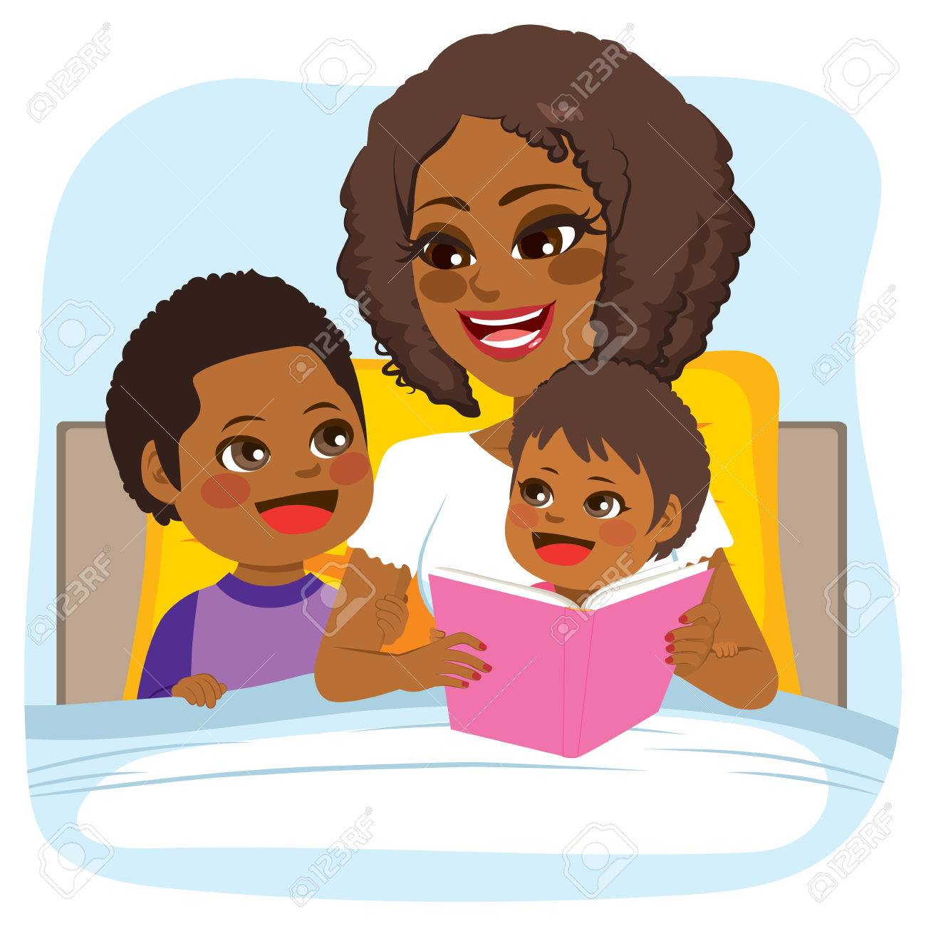 Young African American mother reading bed time tale story to...
