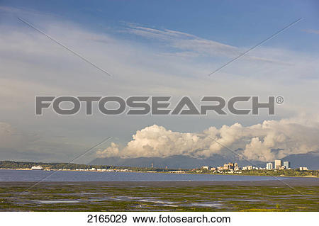 Stock Photograph of Late Afternoon Light Shines Through Clouds.