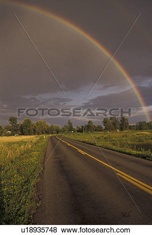 Pictures of rainbow, Upstate, New York, Rainbow over country road.