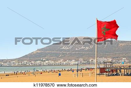 Stock Photography of The beautiful beach in Agadir with flag of.