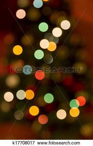 Picture of colourful circles of blurred light against darker.