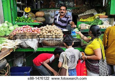 Stock Photo of Vegetable shop at the market, New Delhi, India s88.