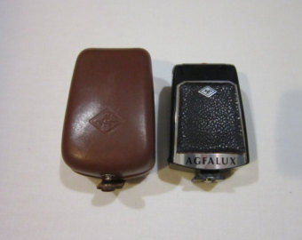 Items similar to Free Shipping!! Agfalux Camera Flash With Case on.