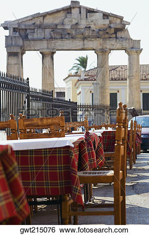 Stock Images of Sidewalk cafe in front of the old ruins, Roman.