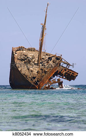 Stock Photo of rusty half of an old ship run aground k8052434.