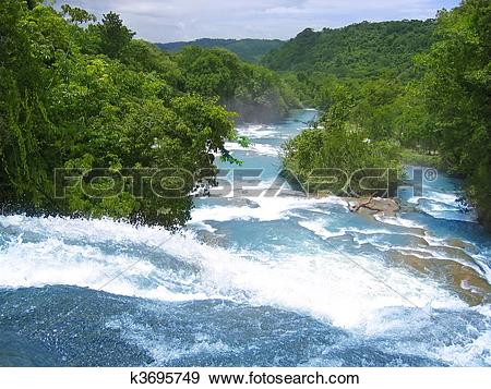 Stock Photograph of Agua Azul waterfalls blue water river in.
