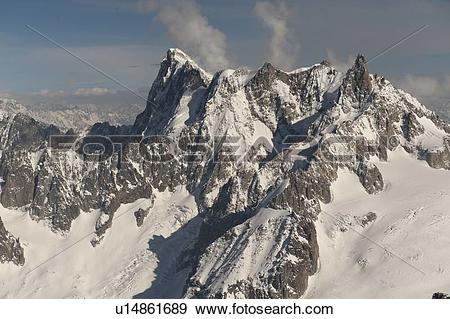 Stock Photograph of Snow covered mountains in winter, Aiguille Du.