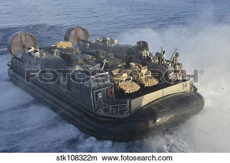 Stock Photo of A landing craft air cushion transits the.