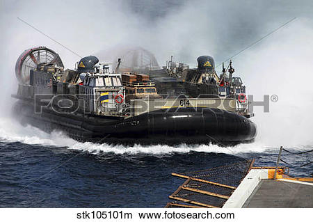 Stock Photo of A landing craft air cushion transits at high speed.