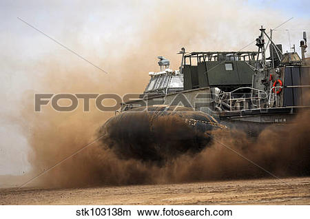 Stock Photo of A Landing Craft Air Cushion coming ashore on a.
