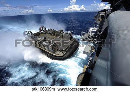 Stock Photo of A landing craft air cushion enters the well deck of.