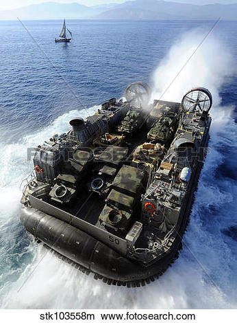 Stock Photo of A Landing Craft Air Cushion exits the well deck of.
