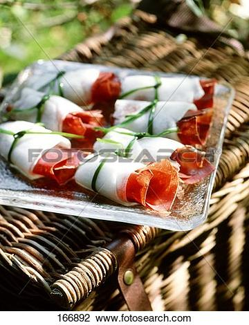 Stock Photo of Melon and ham rolls (honeydew melon and air.