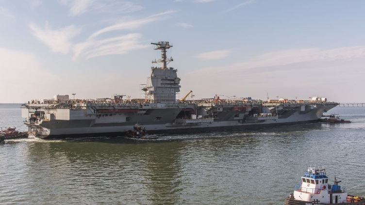 Huntington Ingalls Industries launches aircraft carrier John.