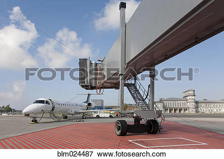 Picture of Boarding Bridge Leading to a Parked Plane blm024487.
