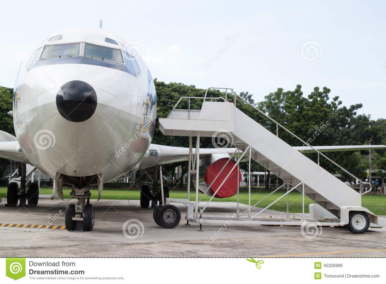Airplane Nose With Passenger Stairs Stock Photo.