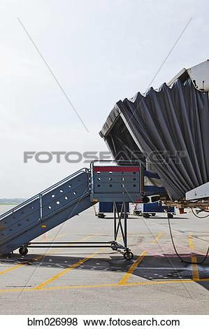 Pictures of Airplane passenger boarding bridge on runway blm026998.