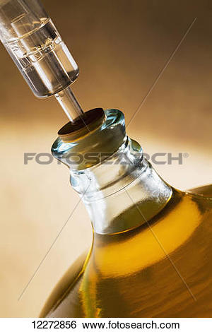 Stock Images of Large glass vessel full of white wine and corked.
