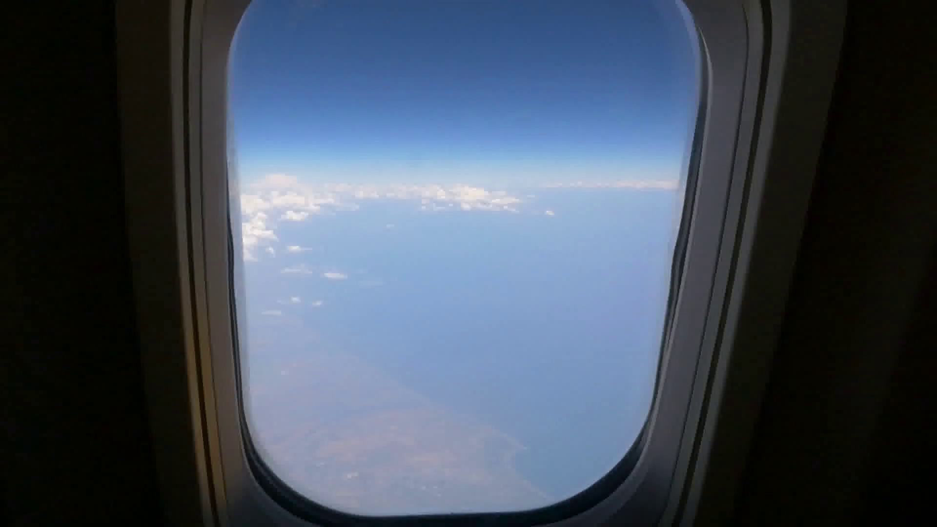 Female hand wave to goodbye from an airplane window. HD Stock Video Footage.